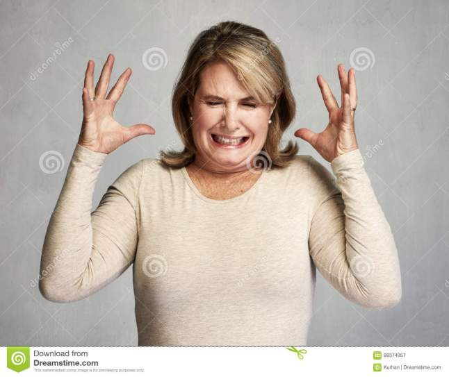 angry-woman-screaming-senior-over-gray-wall-background-88374957